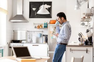 man alone in kitchen 300x200 - Living Alone Tips