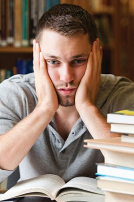 stressed male student 268x402 - Tips In Choosing A College Course